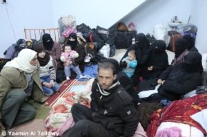 Around 50 Syrians huddle into this small space together to sleep